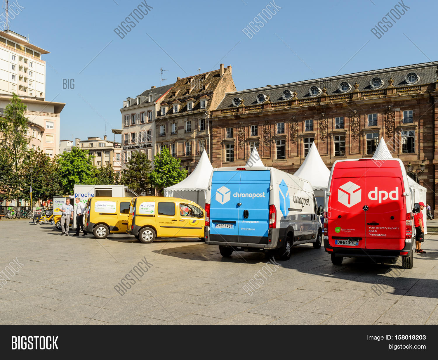 a5b0ebdbc5 STRASBOURG FRANCE - CIRCA 2016  CHRONOPOST DPD and La Poste delivery vans  in center of