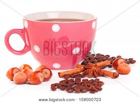 Big mug polka dot of coffee with filberts and spices, isolated on white background