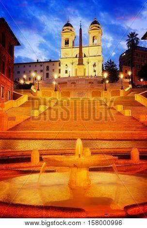 Spanish Steps with boat fountain illuminated at night, Rome, Italy, retro toned