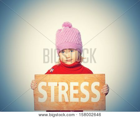 Girl Holding Board With Inscription Stress.