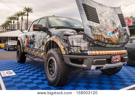 LAS VEGAS NV/USA - NOVEMBER 1 2016: Customized Ford F-150 Raptor truck at the Specialty Equipment Market Association (SEMA) 50th Anniversary auto trade show. Name: Proud Eagle License Plate: Gathering of Nations Powwow