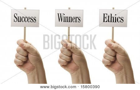 Three Signs In Male Fists Saying Success, Winners and Ethics Isolated on a White Background.