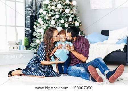 Modern Christmas Family Portrait In Home Holiday Living Room Kids and Baby waiting Santa With Present Gift Box House Decorating By white Xmas Tree Candles Garland