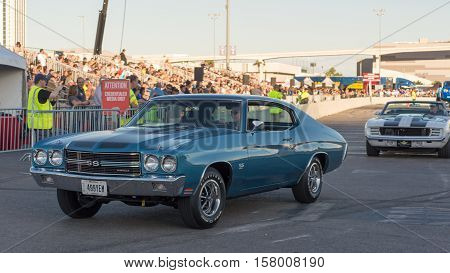 LAS VEGAS NV/USA - NOVEMBER 4 2016: A Chevrolet Chevelle SS followed by a Chevrolet Camaro cars at the Specialty Equipment Market Association (SEMA) 50th Anniversary auto trade show parade.