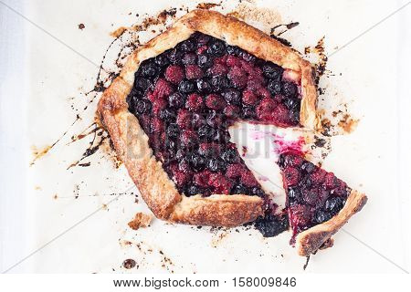 homemade berry galette on a parchment paper