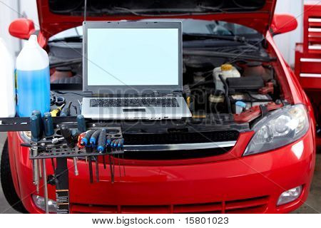 Car with open hood in auto repair shop. poster