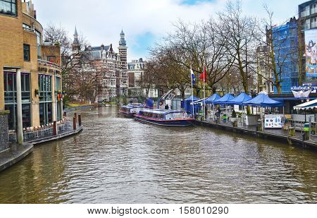 AMSTERDAM HOLLAND, MARCH 28 2015: landscape of Amsterdam canals Holland. Editorial use.