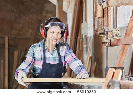 Woman as carpenter during apprenticeship lesson