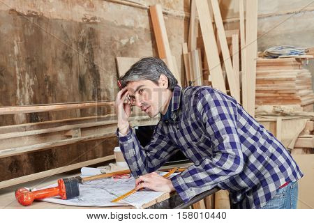 Carpenter planning and thinking about problem and it's solution