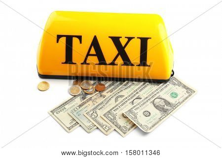 Yellow taxi roof sign with money on white background, closeup