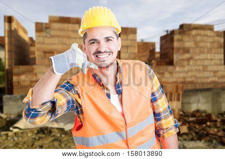 Handsome Construction Engineer Doing A Call Gesture