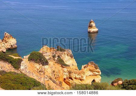 Camilo beach and rocky sea coast in Lagos, Algarve, Portugal