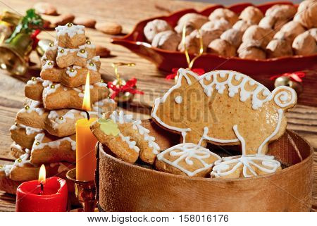 Christmas gingerbread with candles on the table