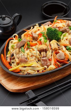 Asia Food. Udon Noodles With Pork On A Black Table.