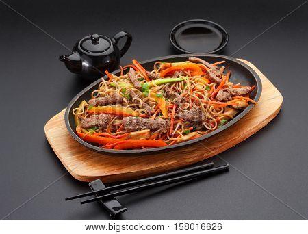 Soba Noodles With Veal Over Black Background