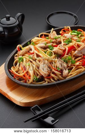 Asia Food. Udon Noodles With Chicken On The Black Table.