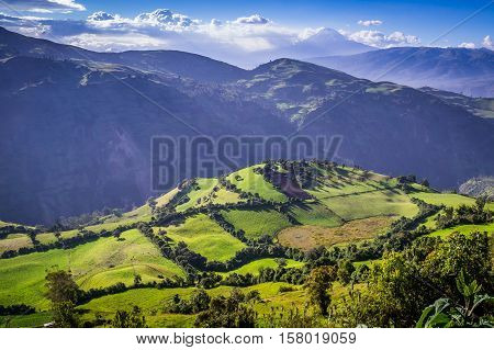 Green Andean landscape in afternoon light near El Altar volcano in Riobamba region, Ecuador
