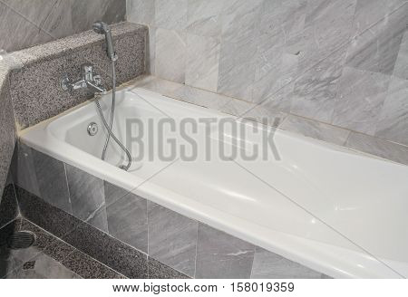 bathroom bathtub modern in marble wall .