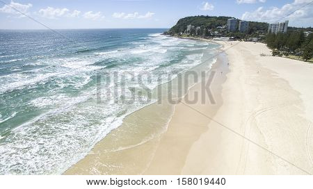 Aerial view of Burleigh beach and headlands at sunrise. Gold Coast, Australia