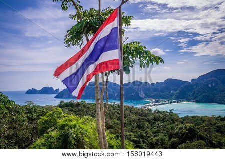View of beautiful Ko Phi Phi Don island from Viewpoint 3 with waving Thailand flag