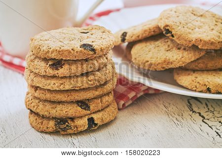 Stack of wholewheat biscuits with raisins on white rustic table