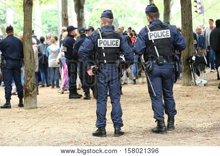 Paris, France - July 14, 2014: French Police Patrol (crs) Assigned To The Surveillance. These Troops