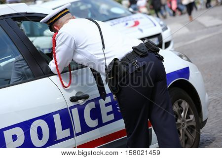 Paris, France - July 14, 2014: French Policeman Assigned To The Surveillance To Ensure The Security