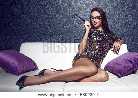 Sexy smart woman in glasses with whip bdsm