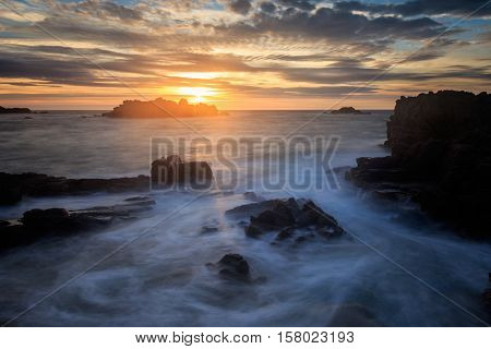 Sunset at Cobo Bay in Guernsey channel islands.