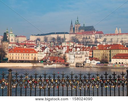 Sunny morning view of Prague Castle in Hradcany, Prague, Czech Republic. Padlocks hanging on the railings in the foreground.
