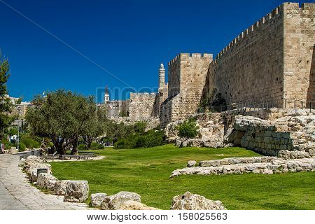 JERUSALEM ISRAEL - APRIL 5: Part of the historic wall of the Old City and the Tower of David near the Jaffa Gate to western edge of the Old City of Jerusalem Israel on April 5 2015
