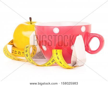 Cup of tea with tape measure, isolated on white background
