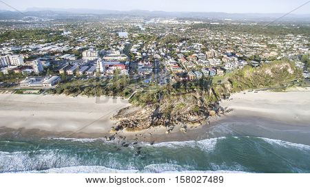 Aerial view of Miami Headland, beach and surrounds as the sunrise glow hits the foreshore. Gold Coast, Australia