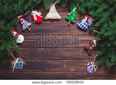 Christmas vintage decor - blue gingham toys on the wooden table with copy space