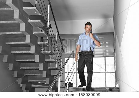 Security man walking on stairs