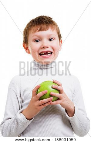 boy showing his missing milk teeth isolated on white background