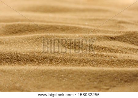 Lines in the sand of a beach. Close up texture