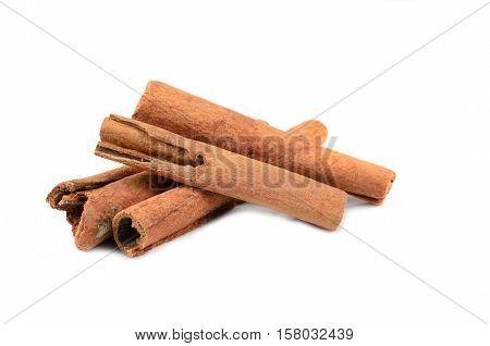 cinnamon, herbs, isolated on white floor background.