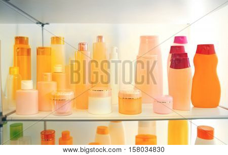 Stand with cosmetic products in retail shop