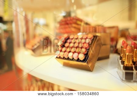 Stand with lipsticks in cosmetic store