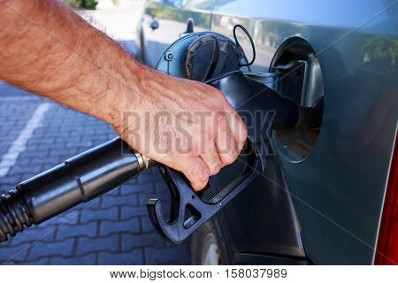car fill with gasoline at a gas station poster