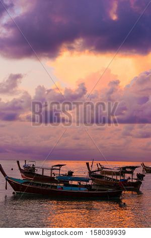 Wooden Fisherman Boat With Sky Background On Sunrise