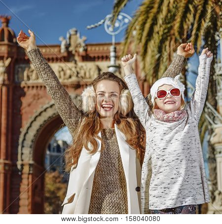 Mother And Child Near Arc De Triomf In Barcelona Rejoicing