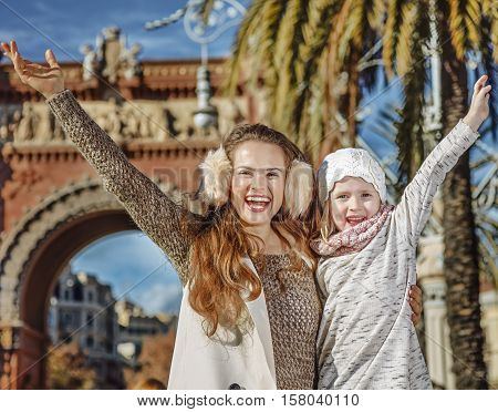 Happy Modern Mother And Child In Barcelona, Spain Rejoicing