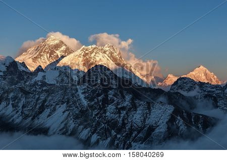 Mount Everest View From Gokyo Ri. Picturesque Mountain Surrounded By Curly Clouds At Sunset. Dramati