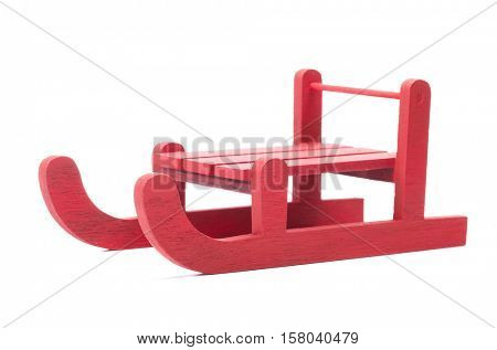 Side view of red sled, isolated on white background