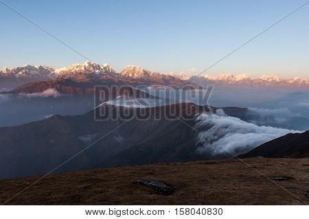 Amazing Mountains Landscape With Beautifully Floating Clouds On The Sunrise. Himalayas Landscape Wit