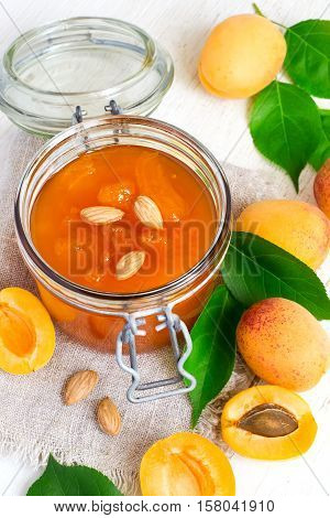 Fresh apricot jam in jar and ripe apricots.