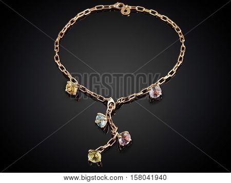 Golden Necklace With Gemstone Isolated On Black