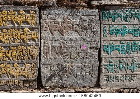 Traditional Buddhist Mani Stones With Buddhist Mantra Om